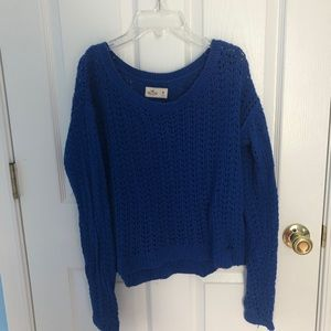 Open stitched blue sweater